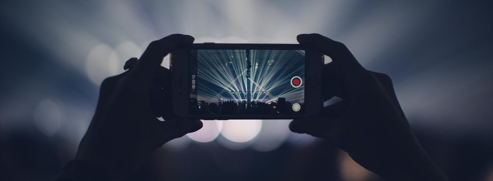 smartphone recording video at concert